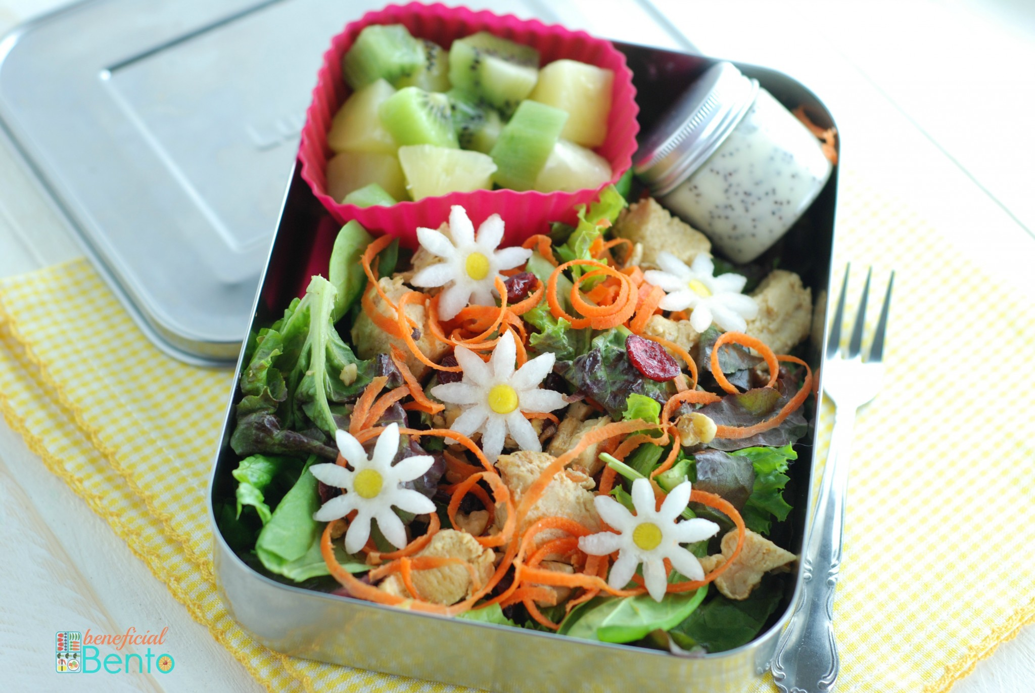 chicken salad bento with poppy seed dressing - the daisies are made with radish, carrots, and a little flower cookie cutter!