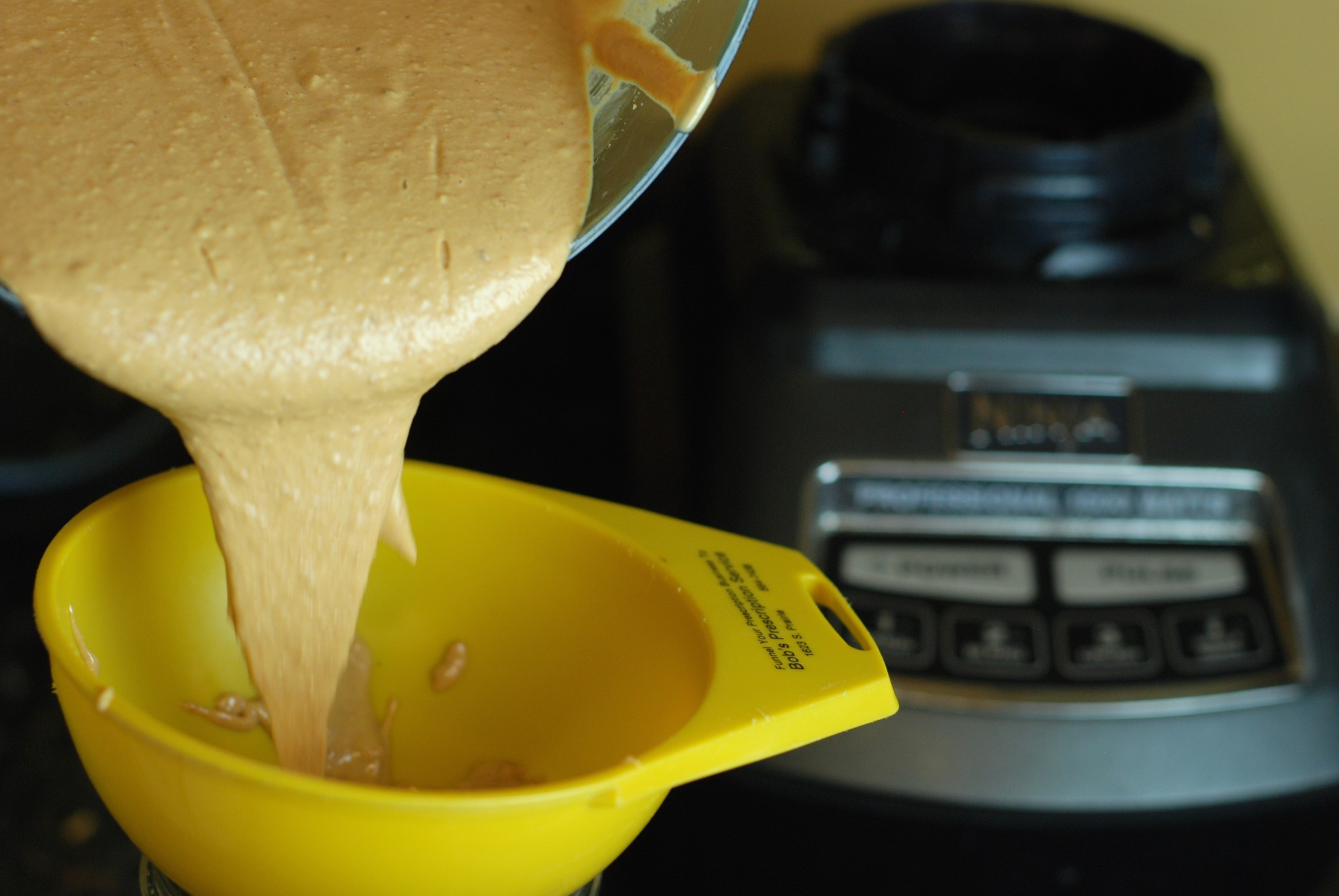 Coconut Cashew Butter, pouring into a jar
