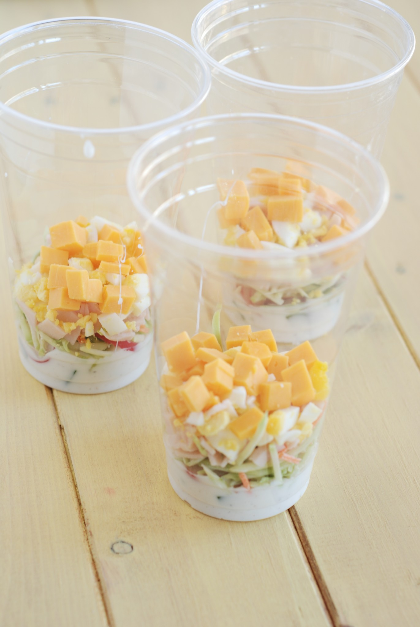 salad cups, meat and cheese layer