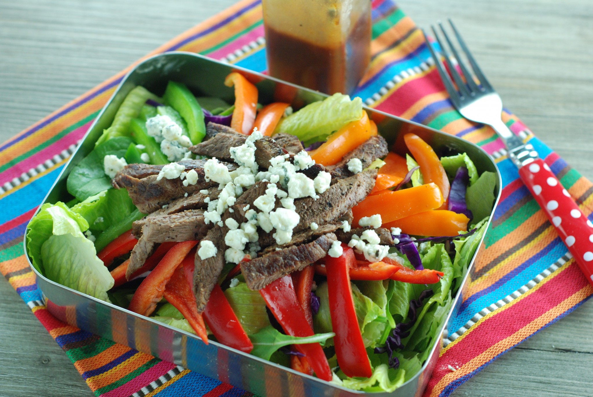 So colorful, tangy, and a great way to use up leftover steak! Recipe at beneficial-bento.com