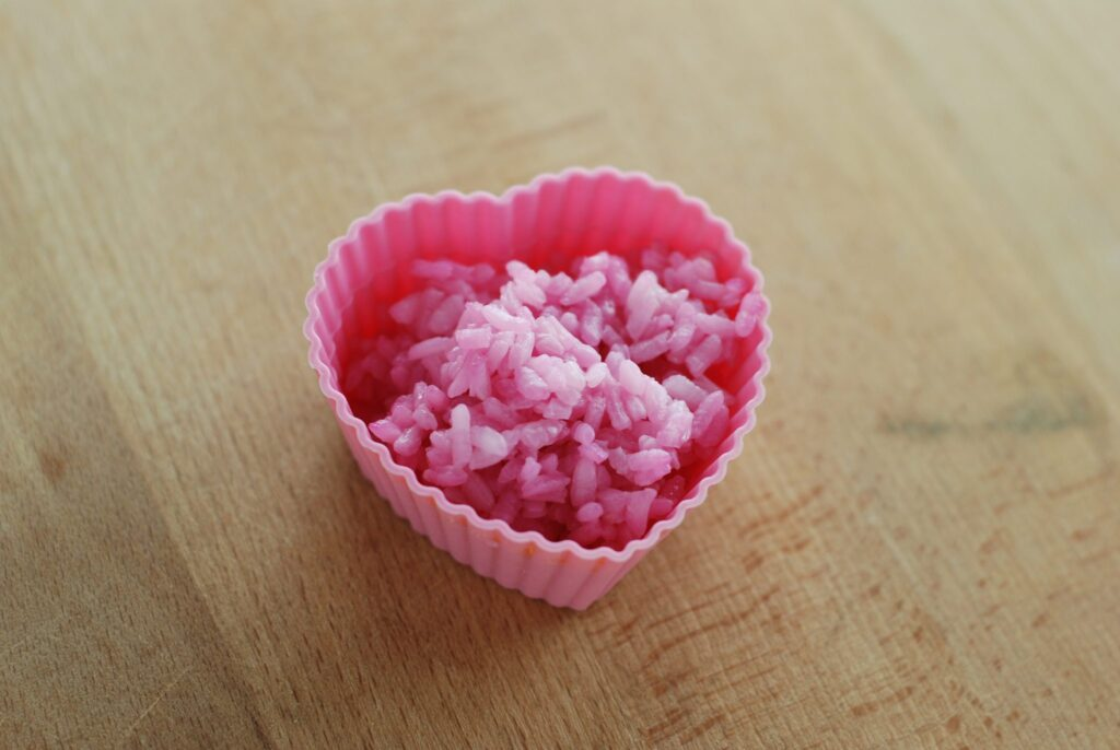 This is a picture of rice that has been tinted pink with beet juice. Read more at beneficial-bento.com