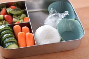 this is a picture of step 5 in the snowman rice ball bento tutorial. Read more at beneficial-bento.com