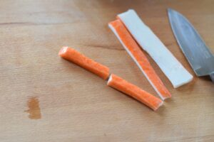 this is a picture of step 10 of the snowman rice ball bento. Read more at beneficial-bento.com