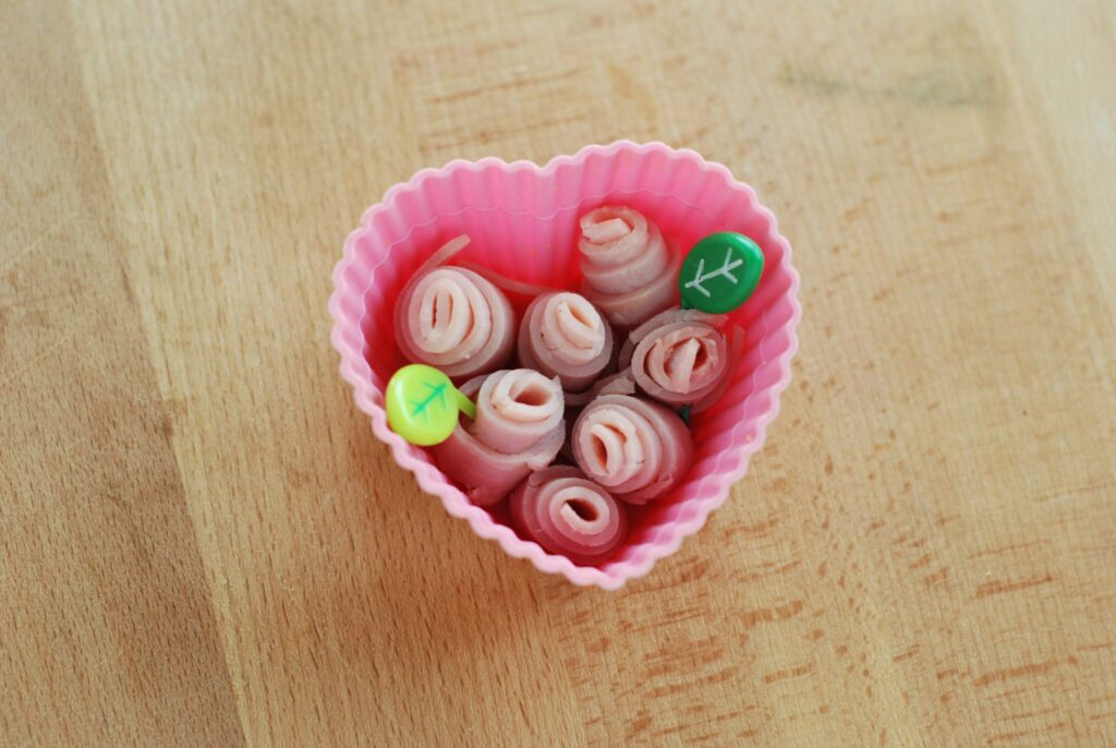 This is a picture of ham rolled into rosette shapes. Read more at beneficial-bento.com