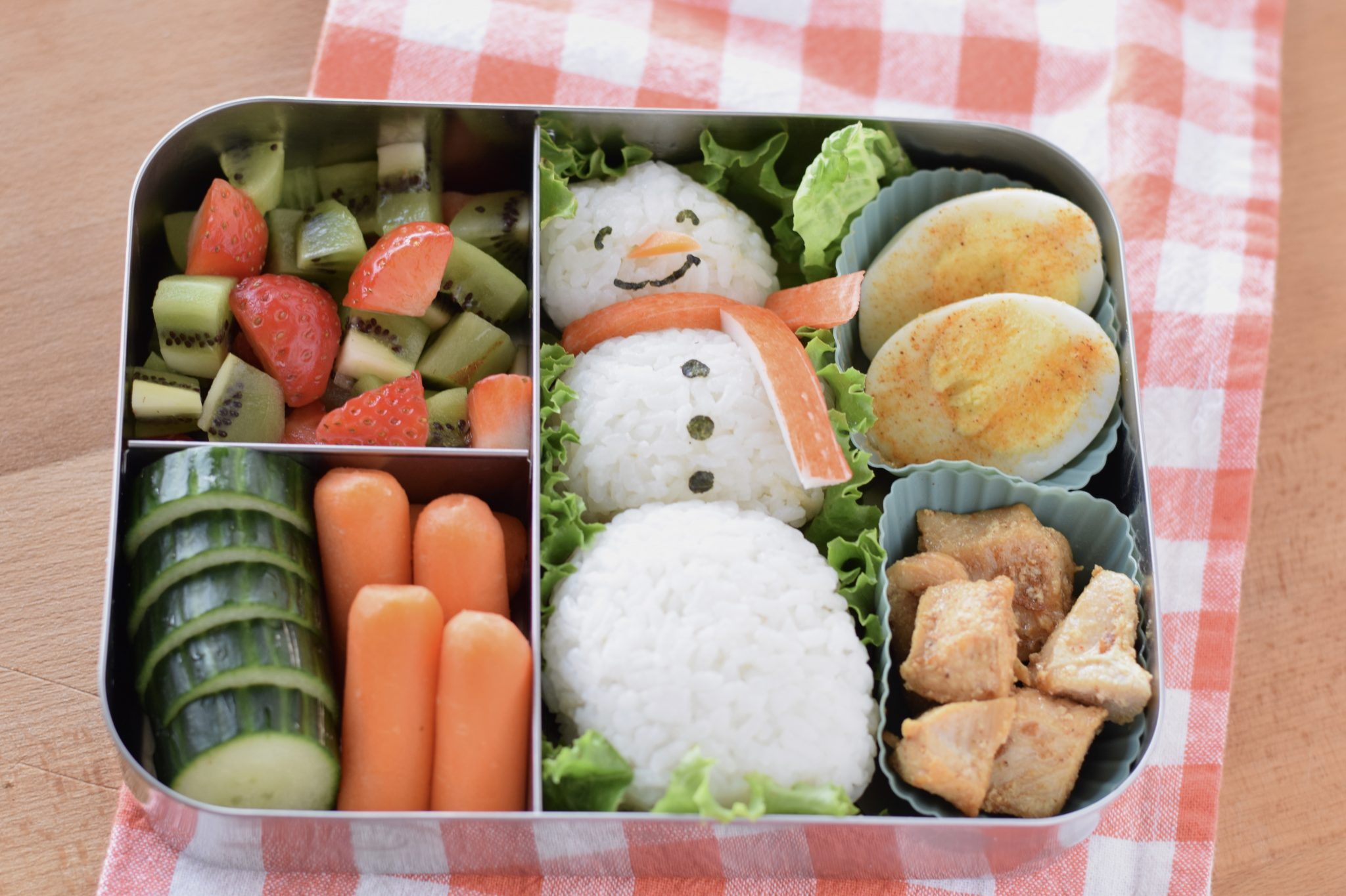 this is a picture of a snowman rice ball bento, recipe at benenficial-bento.com