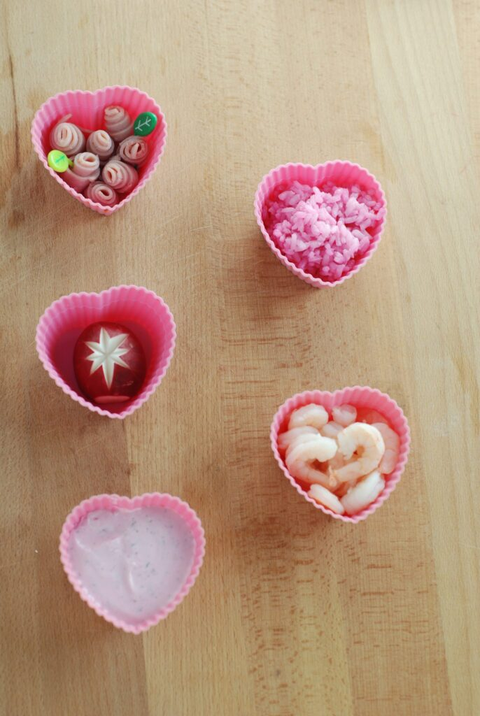 This is a picture of natural pink foods in silicone cups. Read more at beneficial-bento.com