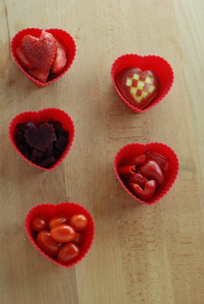This is a picture of natural red food in red silicone cups. Read more at beneficial-bento.com