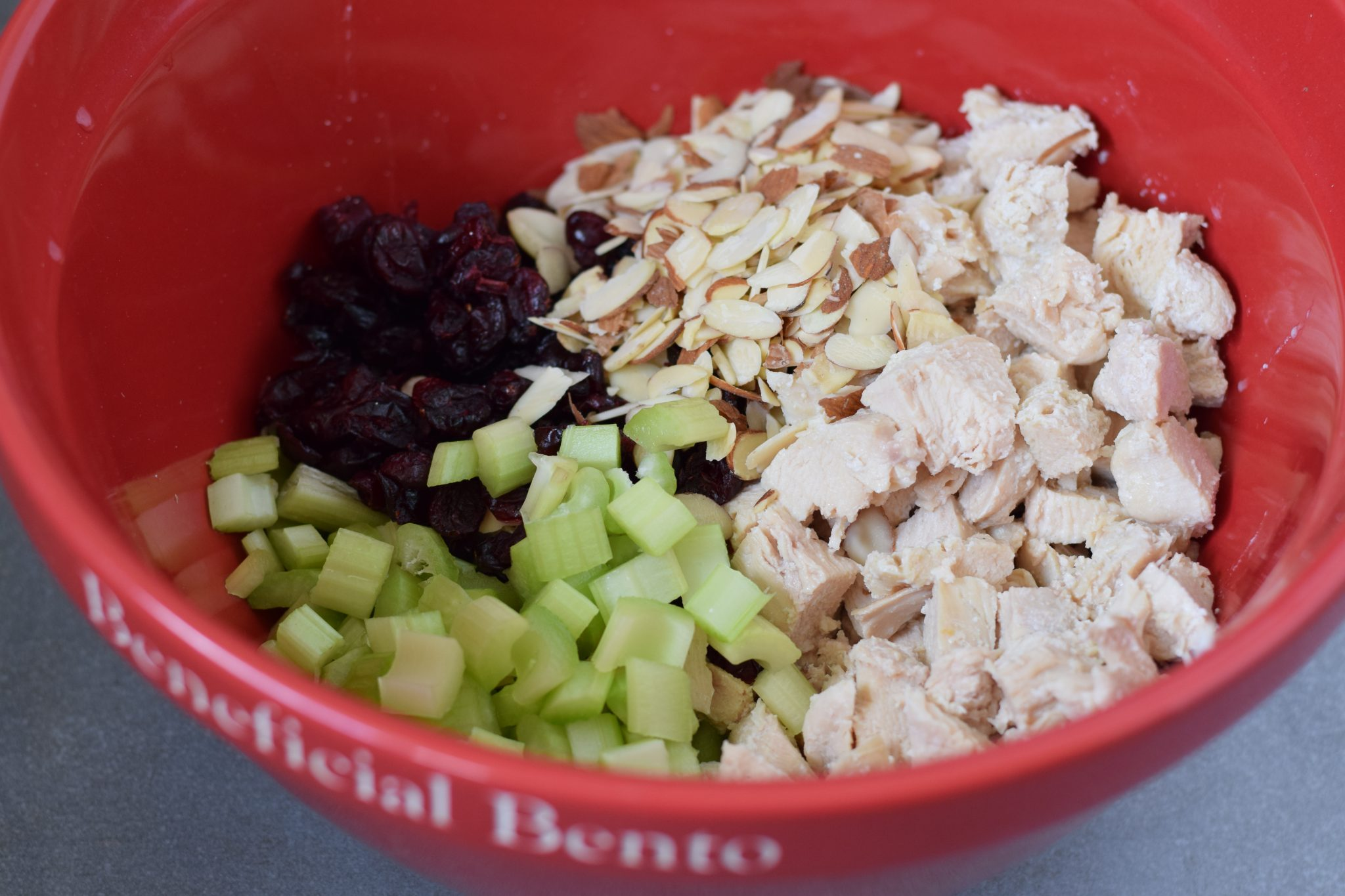 this is a picture of step 2 of how to make Chicken Salad with Cranberries and Poppy Seeds. Recipe at beneficial-bneto.com